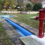 Fibreglassed formal pond