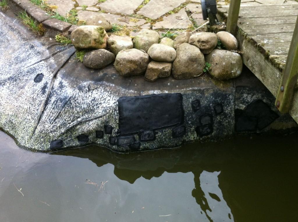 Repaired koi pond by bridge
